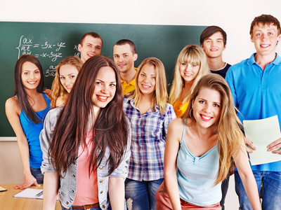 Group student near blackboard.